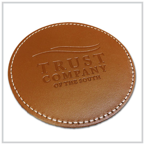 tan round leather coaster with heat deboss imprint only