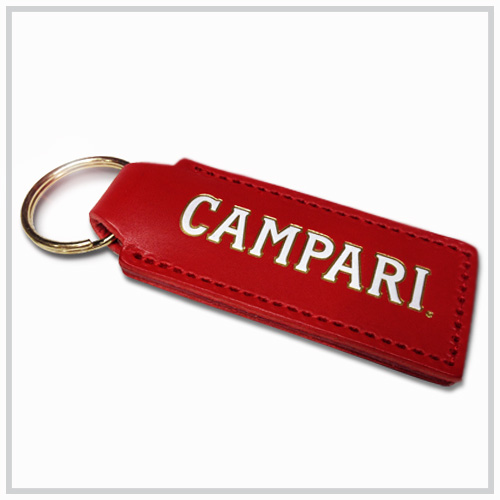 red leather key chain with white and gold deboss imprint