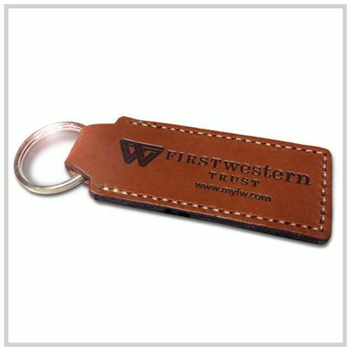 tan leather key chain with black deboss imprint